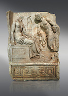 """Roman Sebasteion relief  sculpture of Io and Argos Aphrodisias Museum, Aphrodisias, Turkey. <br /> <br /> A powerful hero is folding a sword gazing closely at a half naked and dishevelled young heroine who sits on a chest like stool. Between, on a pillar base stood a small, separately added statue of a goddess ( now missing). The scene follows a scheme used in the relief panels """"Io guarded by Argos"""". Io was one of Zeus's lovers, and Argos was a watchful giant sent to guard her by Hera, Zeus's wife. .<br /> <br /> If you prefer to buy from our ALAMY STOCK LIBRARY page at https://www.alamy.com/portfolio/paul-williams-funkystock/greco-roman-sculptures.html . Type -    Aphrodisias     - into LOWER SEARCH WITHIN GALLERY box - Refine search by adding a subject, place, background colour, museum etc.<br /> <br /> Visit our ROMAN WORLD PHOTO COLLECTIONS for more photos to download or buy as wall art prints https://funkystock.photoshelter.com/gallery-collection/The-Romans-Art-Artefacts-Antiquities-Historic-Sites-Pictures-Images/C0000r2uLJJo9_s0"""