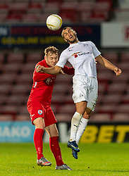 WREXHAM, WALES - Thursday, September 17, 2020: FC Dinamo Tbilisi's Giorgi Gabedava (R) challenges for a header with Connah's Quay Nomads' John Disney during the UEFA Europa League Second Qualifying Round match between Connah's Quay Nomads FC and FC Dinamo Tbilisi at the Racecourse Ground. Dinamo Tiblisi won 1-0. (Pic by David Rawcliffe/Propaganda)