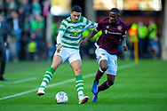 Tom Rogic (#18) of Celtic FC and Arnaud Djoum (#10) of Heart of Midlothian contest the ball during the Betfred League Cup semi-final match between Heart of Midlothian FC and Celtic FC at the BT Murrayfield Stadium, Edinburgh, Scotland on 28 October 2018.