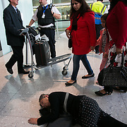 Stay grounded flash mob at Heathrow terminal 2