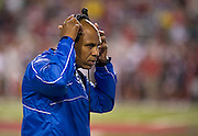 Kentucky Wildcats head coach Joker Phillips takes off a headset during the first half of a game against the Arkansas Razorbacks at Donald W. Reynolds Razorback Stadium in Fayetteville, Ark., on Oct.. 13, 2012. Photo by Beth Hall
