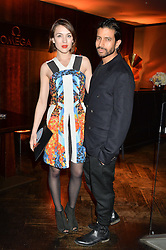 ELLA CATLIFF and NIK THAKKAR at the OMEGA VIP dinner hosted by Cindy Crawford and OMEGA President Mr. Stephen Urquhart held at aqua shard', Level 31, The Shard, 31 St Thomas Street, London, SE1 9RY on 10th December 2014.