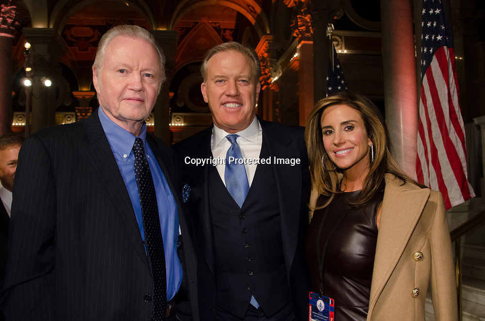 Actor Jon Voight, John Elway and Paige Green attends the Cabinet Dinner at the Library of Congress - Madison Building in Washington DC on January 18, 2017.