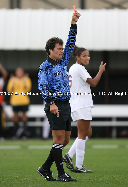 09 December 2007: Referee Misail Tsapos shows a red card to Florida State's Libby Gianeskis (not pictured) in the 83rd minute. The University of Southern California Trojans defeated the Florida State University Seminoles 2-0 at the Aggie Soccer Stadium in College Station, Texas in the NCAA Division I Womens College Cup championship game.