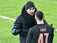 Football - 2020 / 2021 Emirates FA Cup - Round Five - Swansea City vs Manchester City - Liberty Stadium<br /> <br /> Manchester City F.C./ManagerPep Guardiola speaks to Phil Foden OF Manchester City  as he comes on from the bench