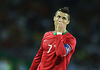Football - European Championships 2012 - Portugal vs. Netherlands<br /> Christiano Ronaldo bites his nails following the opening goal from the Netherlands at the Metalist Stadium, Kharkiv, Ukraine