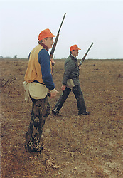 United States President George H.W. Bush, left, and Will Farish hunt quail on the Lazy F Ranch near Beeville, Texas on December 28, 1989.<br /> Mandatory Credit: David Valdez / White House via CNP /ABACAPRESS.COM