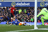 Chris Brunt of West Bromwich Albion (standing) watches as his shot goes just wide of the goal. Barclays Premier League match, Everton v West Bromwich Albion at Goodison Park in Liverpool on Saturday 13th February 2016.<br /> pic by Chris Stading, Andrew Orchard sports photography.