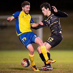 BRISBANE, AUSTRALIA - AUGUST 26: Luke Marsh of the Strikers and Corey Lucas of Moreton Bay compete for the ball during the NPL Queensland Senior Men's Semi Final match between Brisbane Strikers and Moreton Bay Jets at Perry Park on August 26, 2017 in Brisbane, Australia. (Photo by Patrick Kearney)