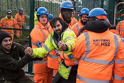 Harefield, UK. 8th February, 2020. HS2 engineers and security guards try to prevent environmental activists from Save the Colne Valley, Stop HS2 and Extinction Rebellion from accessing an area of Harvil Road fenced off in order to carry out tree felling works for the high-speed rail project. The activists were successful in preventing any of the scheduled tree felling by HS2 and after an intervention by a police officer all tree felling work has now been cancelled for the weekend.