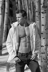 shirtless man in a Winter coat outdoors