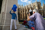 Photographer Martin Parr working in Westminster on the day that Parliament reconvenes after summer recess to debate and vote on a bill to prevent the UK leaving the EU without a deal at the end of October, on 3rd September 2019 in London, England, United Kingdom.