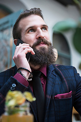 Young man talking on mobile phone