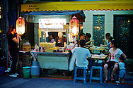 A vendor in Taipei, Taiwan's Shilin Night Market sell snacks.  Taiwan's night markets are famous places to find everything from clothes to food to video games and other entertainment.  Every neighborhood in Taiwan has one, and they're the place to be on a Friday or Saturday night.