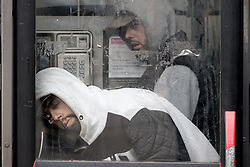 © Licensed to London News Pictures . 06/04/2017 . Manchester , UK . Two men stand slouched over in a telephone box after consuming a rolled cigarette believed to contain spice . An epidemic of abuse of the drug spice by some of Manchester's homeless population , in plain sight , is causing users to experience psychosis and a zombie-like state and is daily being witnessed in the Piccadilly Gardens area of Manchester , drawing large resource from paramedic services in the city centre . Photo credit : Joel Goodman/LNP
