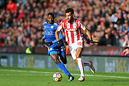 Eric Maxim Choupo-Moting of Stoke City (r) gets away from Wilfred Ndidi of Leicester City. Premier league match, Stoke City v Leicester City at the Bet365 Stadium in Stoke on Trent, Staffs on Saturday 4th November 2017.<br /> pic by Chris Stading, Andrew Orchard sports photography.