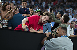 MELBOURNE, Jan. 19, 2018  Actor Will Smith poses for a photo with fans while watching the match between Nick Kyrgios of Australia and Jo-Wilfried Tsonga of France at Australian Open 2018 in Melbourne, Australia, Jan. 19, 2018. (Credit Image: © Zhu Hongye/Xinhua via ZUMA Wire)