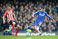 Cesc Fabregas of Chelsea passes the ball past Morgan Schneiderlin of Southampton. Barclays Premier league match, Chelsea v Southampton at Stamford Bridge in London on Sunday 15th March 2015.<br /> pic by John Patrick Fletcher, Andrew Orchard sports photography.