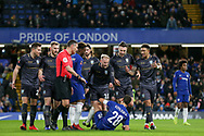 Sheffield Wednesday midfielder Barry Bannan (10) gestures to Chelsea Defender Cesar Azpilicueta after Referee Andre Marriner gives a penalty to Chelsea during the The FA Cup fourth round match between Chelsea and Sheffield Wednesday at Stamford Bridge, London, England on 27 January 2019.