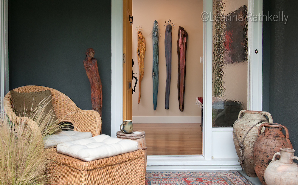 Artist Ginny Glover and her husband David Stuart have renovated a small bungalow in Ten Mile Point and infused it with contemporary style. Her driftwood sculptures greet you at the front entryway.