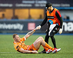 Ross Moriarty of Dragons is helped up by a medic<br /> <br /> Photographer Simon King/Replay Images<br /> <br /> Guinness PRO14 Round 9 - Cardiff Blues v Dragons - Thursday 26th December 2019 - Cardiff Arms Park - Cardiff<br /> <br /> World Copyright © Replay Images . All rights reserved. info@replayimages.co.uk - http://replayimages.co.uk