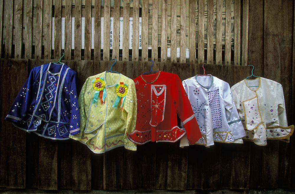 The five different princely jackets of a Shan boy, which he will wear during the three days of Poy Sang Long, the yearly ordination of novice monks, Mae Hong Son, Thailand. April 2003. The jackets are worn in memory of the Buddha.