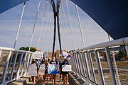 07 SEPTEMBER 2020 - DES MOINES, IOWA: About 300 Des Moines Public School (DMPS) high school athletes march through Des Moines to the Governor's Mansion Monday to protest Gov. Kim Reynolds' recent efforts to reopen schools. DMPS, the largest school district in Iowa, is suing to go to online instruction because of the COVID-19 pandemic. The Governor is trying to force the district to reopen with in person instruction. The state ruled that schools using online education can't participate in extracurricular activities, including sports. The student athletes, who all wore face masks to comply with CDC guidelines, were marching to demand the ability to participate in sports despite using online instruction.      PHOTO BY JACK KURTZ