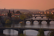 View of the city, the Vltava and bridges of Prague from Letna Park Prague, Czech Republic at sunset.