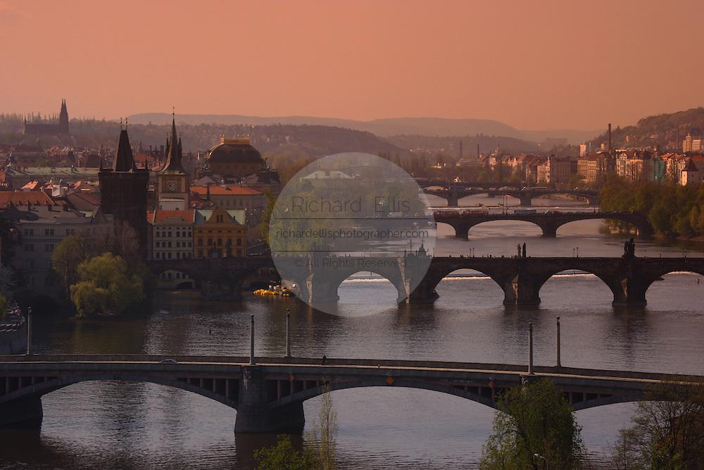 View of the city, the Vltava and bridges of Prague from Letna Park Prague, Czech Republic at sunset.