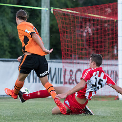 BRISBANE, AUSTRALIA - FEBRUARY 25: Aaron Reardon of the Roar has his shot on goal blocked by Tyler Wagstaffe of Olympic FC during the NPL Queensland Senior Men's Round 1 match between Olympic FC and Brisbane Roar Youth at Goodwin Park on February 25, 2017 in Brisbane, Australia. (Photo by Patrick Kearney/Olympic FC)