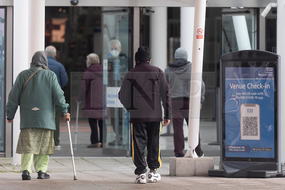© Licensed to London News Pictures. 11/01/2021. London, UK.Elderly people arrive at the Excel Centre Nightingale Hospital to receive a Covid-19 vaccination jab. The hub is one of a few hubs around the Uk to administer mass vaccination jabs. Photo credit: Ray Tang/LNP