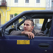 A taxi driver in Transylvania, Romania. 23rd July 2011. Photo Tim Clayton