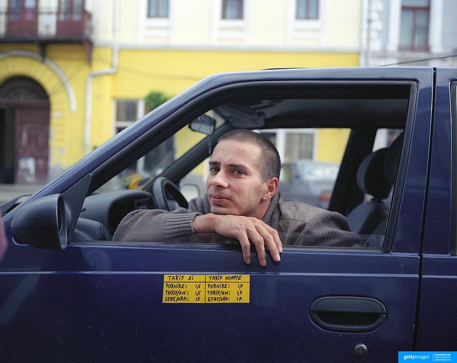 A taxi driver in Transylvania, Romania. 23rd July 2011. Photo Tim Clayton
