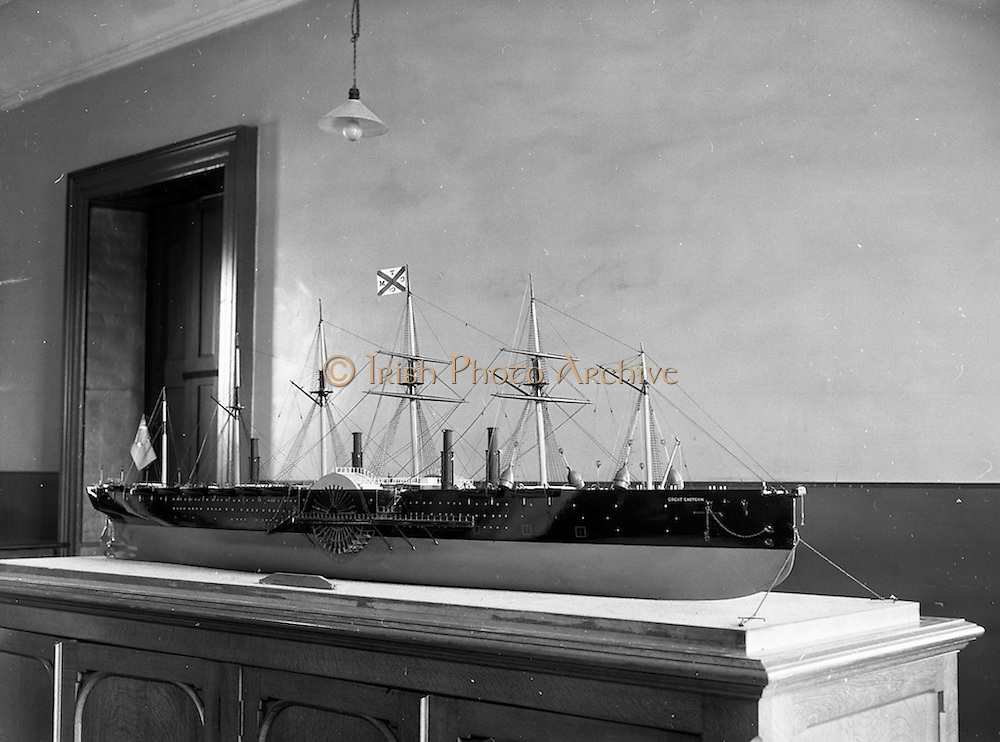 """28/05/1959<br /> 05/28/1959<br /> 28 May 1959<br /> A model of the ship """"Great Eastern"""" a 20,000 ton Iron Paddle Steamer which was to be the centrepiece of the Maritime Institute of Ireland Exhibition at the Whraf, Dun Laoghaire being moved to the exhibition hall by a special squad of C.I.E. removal men. A view of the model."""