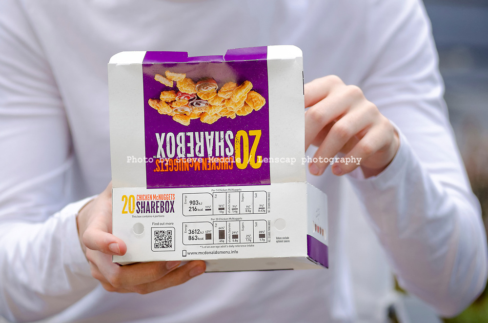London, England - May 30, 2017: Box of McDonald's Chicken McNuggets, McDonald's is a fast food restaurant chain founded in 1940.
