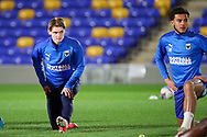 AFC Wimbledon midfielder Jack Rudoni (12) warming up prior to kick off during the EFL Sky Bet League 1 match between AFC Wimbledon and Gillingham at Plough Lane, London, United Kingdom on 23 February 2021.