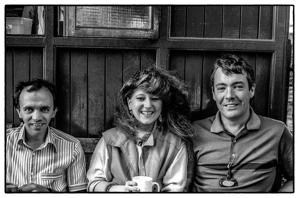 The photographer (Jacky Chapman) with the cabbies having tea. Green Cabbie Shelter, Pimlico, London, UK, 1985