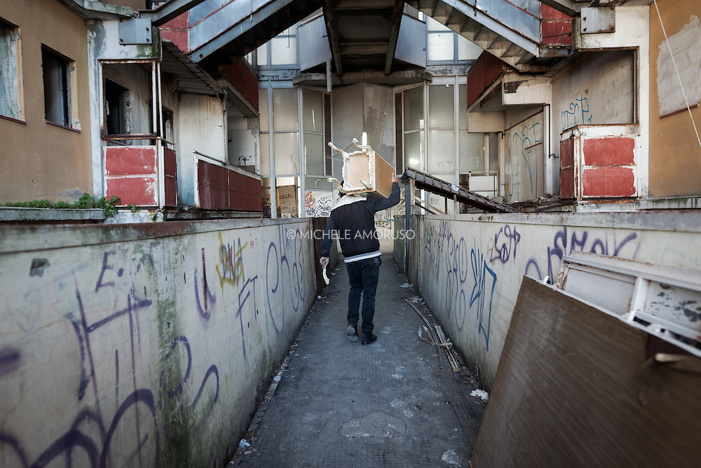 """Italy, Scampia (Naples). On November 10 it started emptying of the """"Vele"""", buildings became famous worldwide as one of the most important centers of crime and drug dealing. Families, after almost forty years in the """"Vele"""", received new apartments in which to move, the old structures, however, will be demolished to facilitate the resumption of the neighborhood and eliminate the huge degradation. The housing complex of """"Vele"""" of Scampia, designed by Franz Di Salvo, was illegally occupied by many families left homeless after the 1980 Irpinia earthquake. The celebrity of """"Vele"""" is also due to the film """"Gomorrah"""" directed by Matteo Garrone and the homonym TV series. Italy, Scampia (Naples). On November 10 it started emptying of the """"Vele"""", buildings became famous worldwide as one of the most important centers of crime and drug dealing. Families, after almost forty years in the """"Vele"""", received new apartments in which to move, the old structures, however, will be demolished to facilitate the resumption of the neighborhood and eliminate the huge degradation. The housing complex of """"Vele"""" of Scampia, designed by Franz Di Salvo, was illegally occupied by many families left homeless after the 1980 Irpinia earthquake. The celebrity of """"Vele"""" is also due to the film """"Gomorrah"""" directed by Matteo Garrone and the homonym TV series. Italy, Scampia (Naples). On November 10 it started emptying of the """"Vele"""", buildings became famous worldwide as one of the most important centers of crime and drug dealing. Families, after almost forty years in the """"Vele"""", received new apartments in which to move, the old structures, however, will be demolished to facilitate the resumption of the neighborhood and eliminate the huge degradation. The complex of """"Vele"""", designed by Franz Di Salvo, was illegally occupied by many families left homeless after the 1980 Irpinia earthquake. The celebrity of """"Vele"""" is also due to the film """"Gomorrah"""" and TV series."""