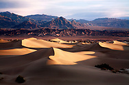 An Eerie And Bizarre Mars Like Landscape, Sand Dunes And Mountains In Early Morning Light At Stovepipe Wells, Death Valley National Park, California USA
