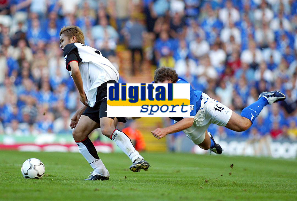 Photograph: Scott Heavey.<br />Birmingham City v Fulham from St.Andrews. 14/09/2003.<br />David Dunn (right) goes flying under pressure from Junichi Inamoto.