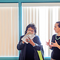 022714       Cable Hoover<br /> <br /> Ruthda Thomas, left, takes notes as she talks to event organizer Chenoa Bah Stilwell-Jensen during the Child Food Summit at Navajo Technical University in Crownpoint Thursday.