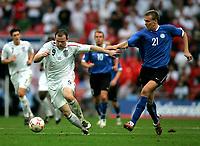 Photo: Tom Dulat.<br /> England v Estonia. UEFA European Championships Qualifying. 13/10/2007.<br /> Taavi Rahn of Estonia and Wayne Rooney of England with the ball.