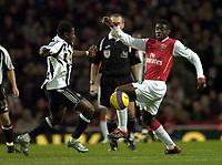 Photo: Olly Greenwood.<br />Arsenal v Newcastle United. The Barclays Premiership. 18/11/2006. Newcastle's Obafemi Martins and Arsenal's Kolo Toure