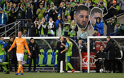 November 30, 2017 - Seattle, Washington, U.S - Soccer 2017: Seattle Head Coach BRIAN SCHMETZER congragulates CLINT DEMPSEY (2) as he comes off the field near the end of the match as the Houston Dynamo play the Seattle Sounders in the 2nd leg of the MLS Western Conference Finals match at Century Link Field in Seattle, WA. (Credit Image: © Jeff Halstead via ZUMA Wire)