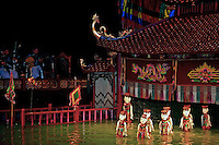"""Vietnamese water puppets at the puppet show in  Hanoi.  Though water puppet shows were originally presented as an amusement for rice farmers, using rice paddies for the """"stage"""", they have become a big hit, especially in Hanoi."""