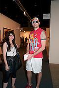 JAC LAHAV; NATALY ABRAMOVITCH; , Opening of Art Basel Miami Beach. Convention Centre.  Miami Beach. 30 November 2010. -DO NOT ARCHIVE-© Copyright Photograph by Dafydd Jones. 248 Clapham Rd. London SW9 0PZ. Tel 0207 820 0771. www.dafjones.com.