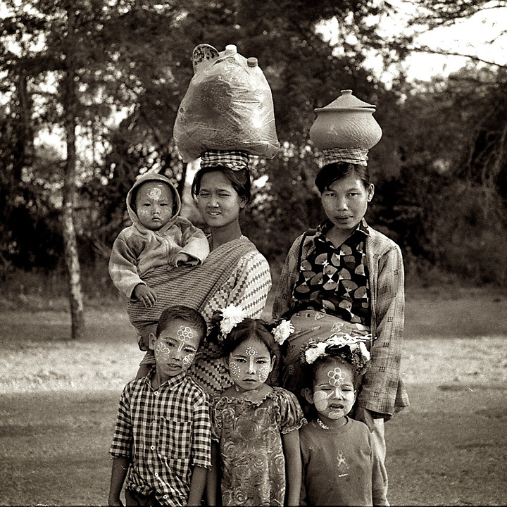 A burmese family of vendor is posing for a portrait on the street of Bagan, Myanmar