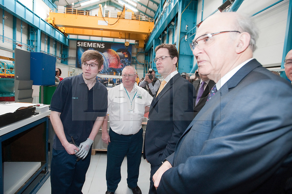 RE-ISSUE NOTE THIS IS A TODAY PICTURE © London News Pictures. 10/03/2012.  Newcastle, UK. Liberal Democrat leader NICK CLEGG and Business Secretary VINCE CABLE speaking to craft apprentice Dan Patterson (20) at Siemens Energy Service Training Centre in Newcastle Upon Tyne on March 11th 2012. The Liberal Domocrat Spring Conference is being held in Newcastle this weekend. Photo credit : Ben Cawthra/LNP