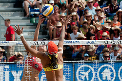 Sara Goller of Germany pokes over Juliana Felisberta Silva of Brazil block at A1 Beach Volleyball Grand Slam tournament of Swatch FIVB World Tour 2010, semifinal, on July 31, 2010 in Klagenfurt, Austria. (Photo by Matic Klansek Velej / Sportida)