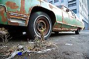 an old rusty big American car